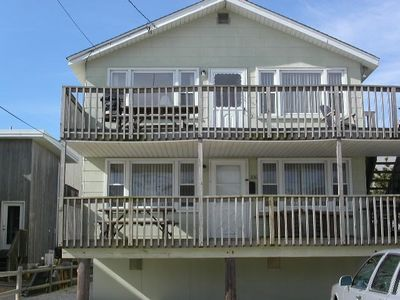 Photo for 50 ft from the Beach w/ beautiful views. Ideal place to bring the family & kids