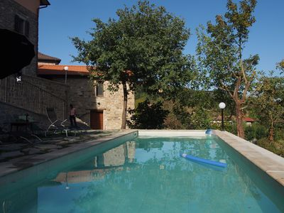 The shared pool is situated across a small vineyard (2 min walk; Casa Vigneto is just visible here in the background behind the trees)