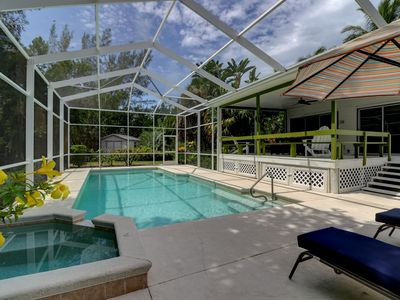 Photo for Coconut Palms: Charming Near Beach Cottage Nestled in the Heart of Sanibel!