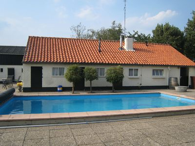 Photo for An attractive holiday home with a swimming pool in a beautiful nature reserve.