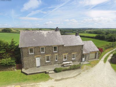 Photo for Spacious and comfortable farmhouse set in beautiful countryside 2 miles from charming New Quay with