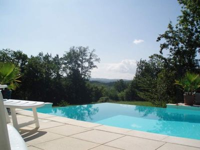 Photo for SUPERB HOLIDAY COTTAGE. INFINITY SWIMMING POOL. LARGE GARDEN. WIFI. NEAR SARLAT.
