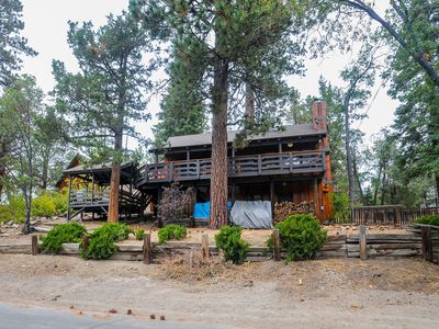 A vast, multi-level deck and rustic interior await at this cozy cabin