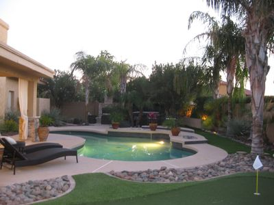 Resort-Style Backyard with Pool, Hot Tub, Fireplace and Putting Green