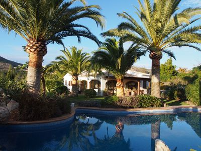 Photo for An Amazing Family Home Set Within Tranquil Grounds With A Palm Fringed Free-form