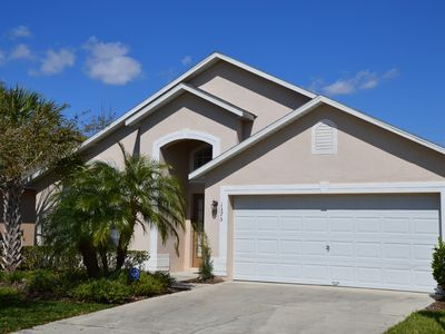 Photo for 4 bed pool home, centrally located in Seasons Blvd near Disney!