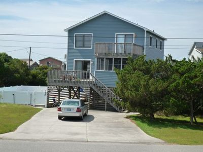 Front of house, pool on the left side of house, two decks.