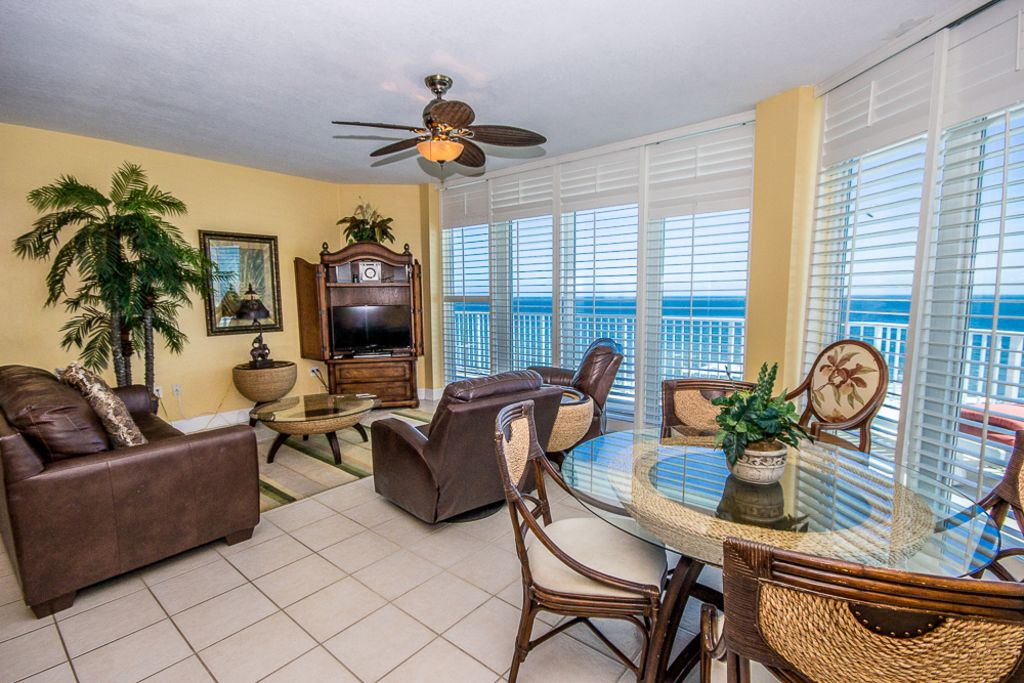 Lighthouse 1118 - Corner Unit with Floor to Ceiling Windows!  Located Beach Front in Gulf Shores!  Plenty of Space for the Entire Family!  Free WiFi, 3 Outdoor Pools, 1 Indoor Pool, Sauna, Fitness Room, and Extra Large Private Balcony Overlooking the Turquoise Water in Every Room!  Come Play in the Sand!