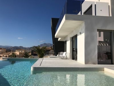 Photo for Fantastic new modern villa with infinity pool, wifi, air conditioning