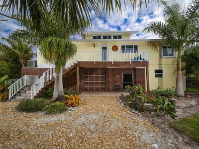 Photo for 4 Bedroom pool home on Lemon Bay with private dock!