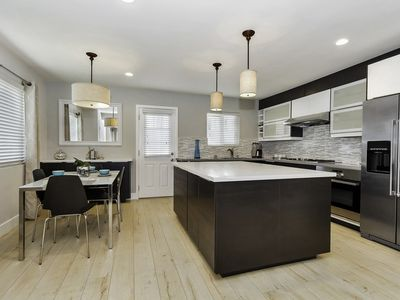 Photo for Newly remodeled home with direct access garage - Beach close