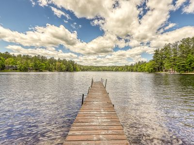 Photo for NEW LISTING! Lakefront cabin with sandy beach, dock, multiple fireplaces