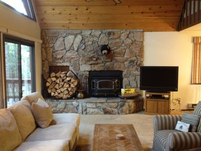 Fireplace and hearth with TV with access to deck