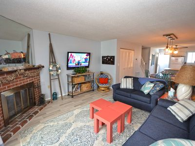 Photo for Nice, comfortable 2-bedroom condo with free WiFi, a boat slip, and an outdoor pool located uptown on the bay water!