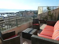 Beautifully decorated apartment with a lovely terrace looking over the harbour