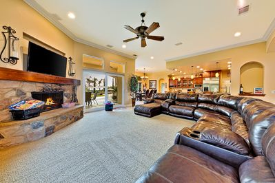 Luxury living room with flat screen TV and fireplace