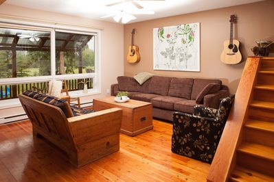 Open plan living room with guitars at the ready