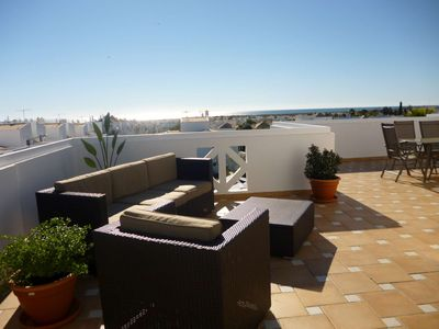 Photo for Apartment on top floor with view to the sea and swimmingpool, Algarve