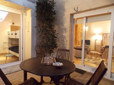Photo for Charming apartment with patio in the heart of the city