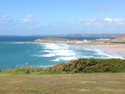 Photo for Stunning views of Fistral Bay. Dog friendly. Walk to Fistral Beach & NT Crantock