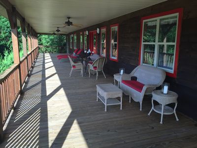 Very Big Porch to sit and watch the river.