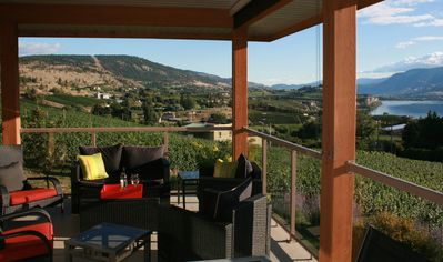 THE DECK OFF THE KITCHEN OVERLOOKING LAKE OKANAGAN AND THE LOCAL VINEYARDS