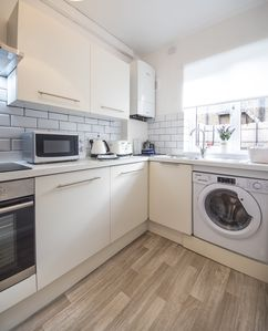 The fully fitted modern kitchen with up-to-date equipment and cooking utensils
