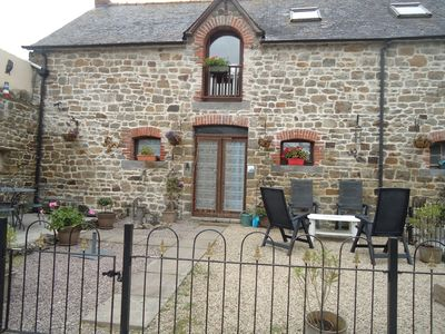Photo for Seaside holiday cottage-in the heart of the quaint village of Cherrueix