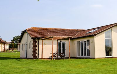 Photo for Beautiful, spacious, contemporary, family-friendly bungalow, sea view, sleeps 4.