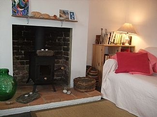Cosy living room with woodburning stove, so the cottage is lovely for winter too