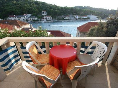 Photo for Two bedroom apartment with terrace and sea view Povlja, Brač (A-2958-a)