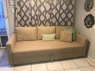 Comfortable sofa bed just pull it out and you can sleep in a queen size bed