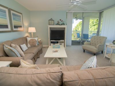 Photo for Perfect family condo- beach towels, chairs & toys included! BBQ, pool, cable