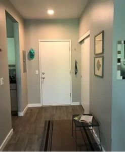 Inside entry-way to the apartment. (Very large closet on the right. Two box fans are in there for your use throughout the studio apartment.)