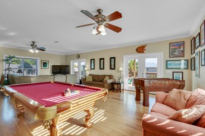 Game Room - Prepare to entertain in the main house game room with a foosball and pool table.