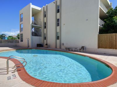 Photo for Modern condo with shared pool only moments away from the beach