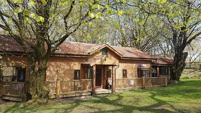 Photo for Woodpecker Lodge, a secluded log cabin with hot tub in beautiful north Devon