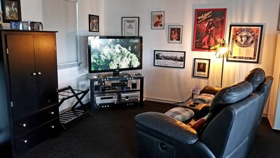 55 inch TV with Direct TV and NFL ticket, motorized reclining theater chairs