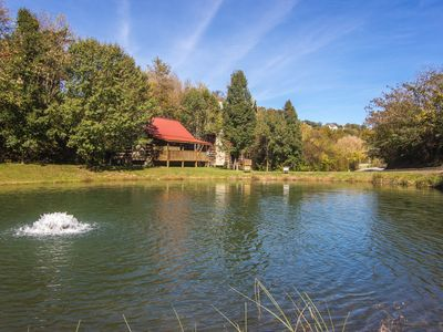 Photo for Real log cabin on a fishing pond-Free Wifi-No steep roads-1.5 Mi to Pkwy-Pets OK
