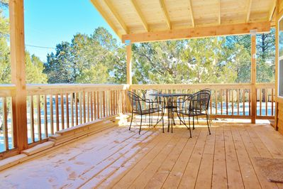 Breath in the fresh air of the beautiful outdoors on the large covered porch.