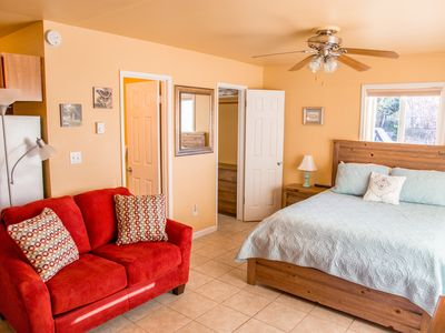 Photo for Quaint Studio Cottage, Walk downtown, Pet friendly, fenced yard, covered patio