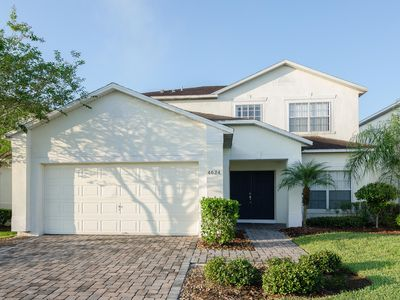 Photo for Pet friendly 6 BR home with pool & spa. Gated community near Disney. Sleeps 15.