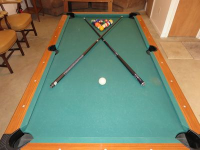 POOL TABLE IN BILLIARD ROOM WITH SEATING, RADIO, AND FOOSBALL TABLE
