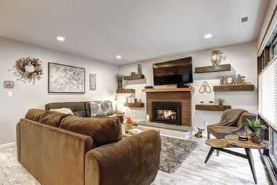 Living area with Gas fireplace and 55 inch T.V. Hulu, Netflix, Direct T.V & More