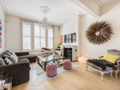 Photo for Impeccable 5BR house with garden and roof terrace 20min to Victoria St, by Veeve