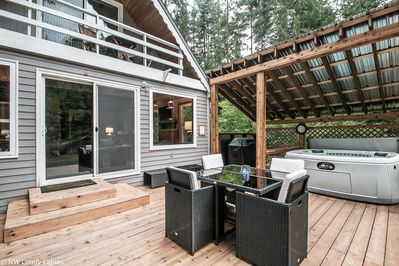Fantastic back deck area with private covered hot tub, propane grill and a place to enjoy a cup of coffee while listening to the song of the river.