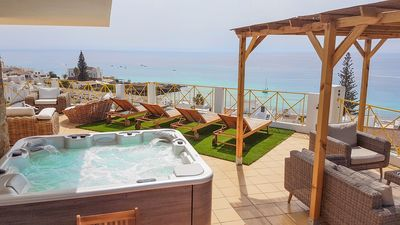 Photo for Private terrace, stinging view of the ocean, 5 minutes walking to the beach.