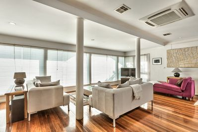 Lounge with beautiful large windows and spotted gum timber floor