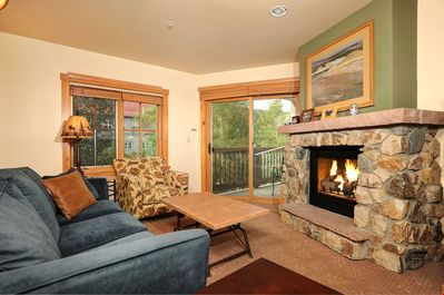 The fireplace provides warmth and coziness to the spacious living area
