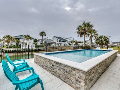 Photo for Summer Special! Ocean View Channel Home w/ Pool in One of TripAdvisor's Top 25 Beaches in the US!